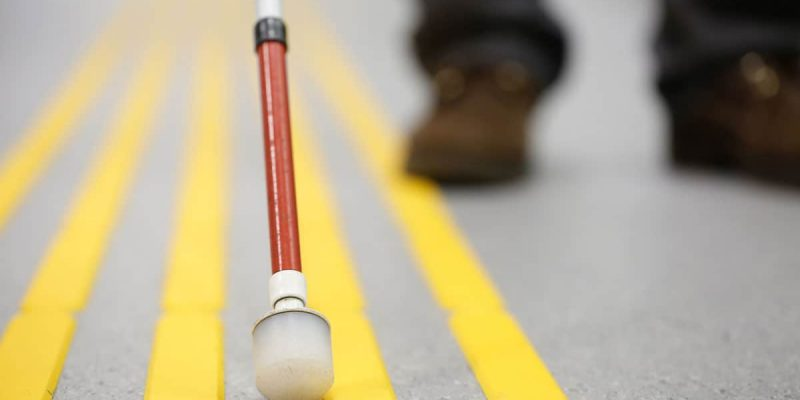 Blind Walking Stock on Road Yellow Lines