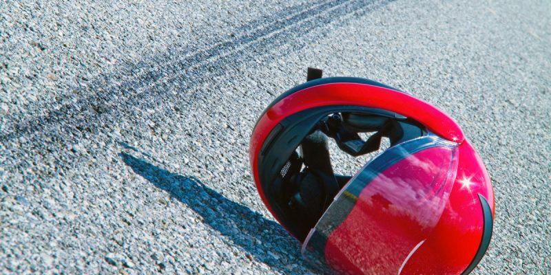Motorcycle Accident Helmet in Road