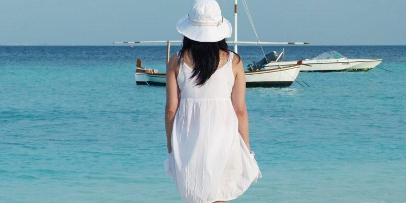 Woman Looking at Beach Sail Boats