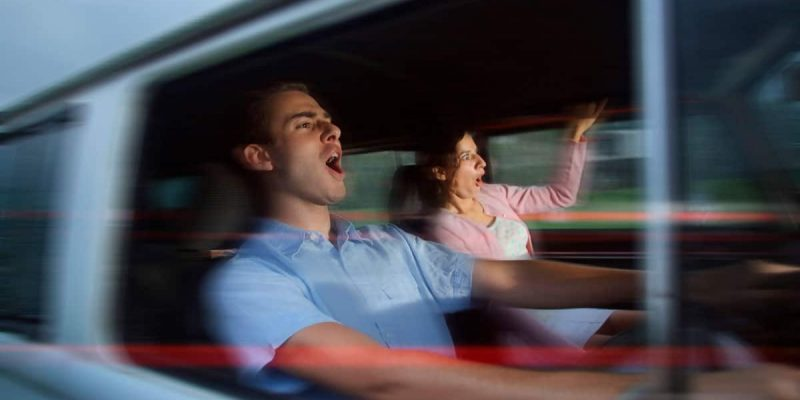 Man and woman driving fast
