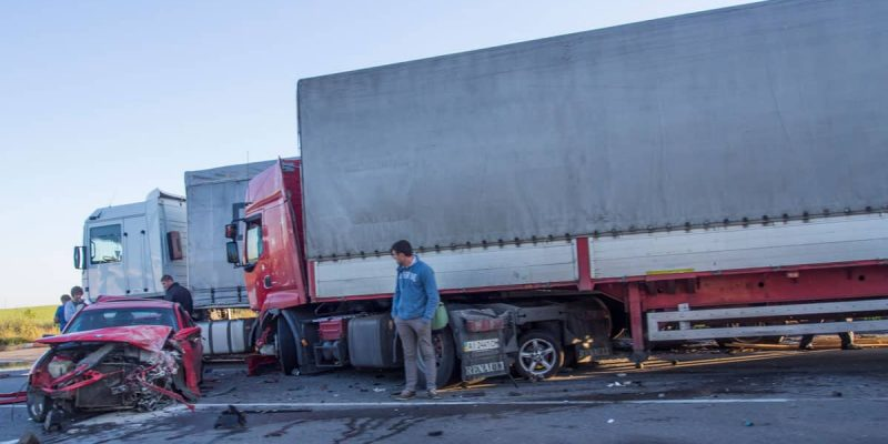 Semi Truck and Car accident with People looking